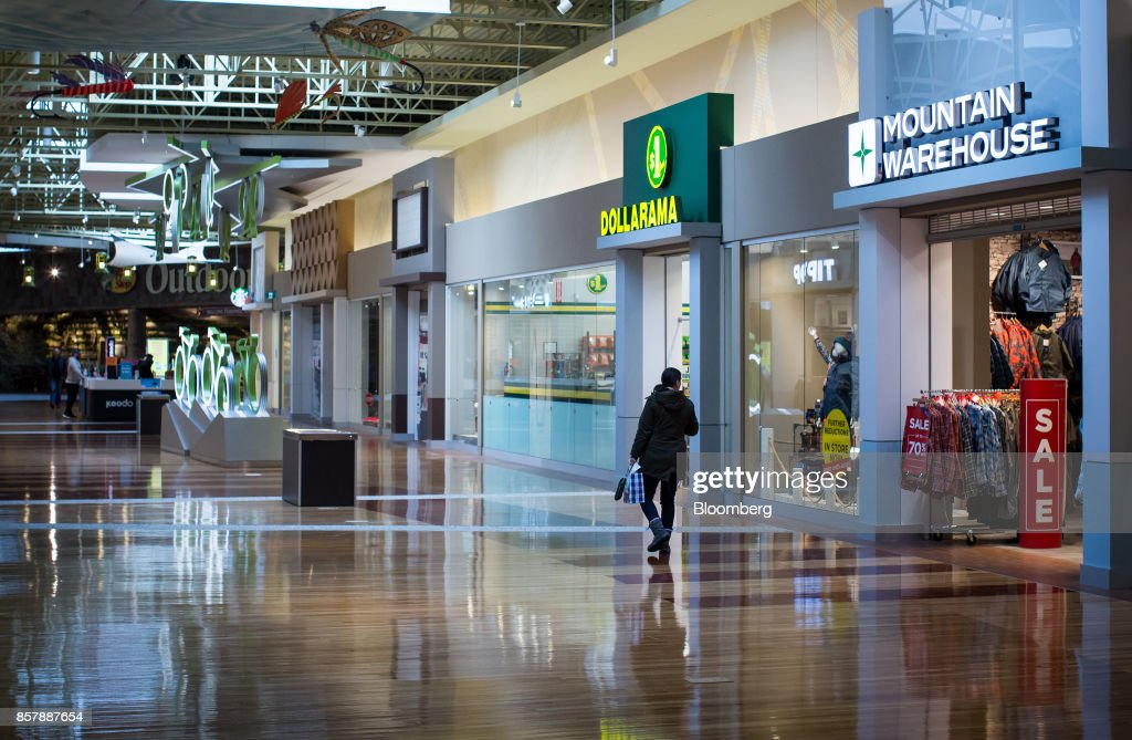 A shopper walks through the Tsawwassen Mills mall in Tsawwassen, British Columbia, Canada, on Wednesday, Feb. 8, 2017. The dayTsawwassen Millsopened last October in suburban Vancouver, shoppers lined up before dawn to get a first shot at Canada's biggest newmall in almost a decade. The mall is just onemanifestation of theeconomic boom underway inTsawwassenFirst Nation, an aboriginal community about 20 miles from both downtown Vancouver and the U.S. border. Nearby, there's a master-planned residential developmentwherehomes start at C$619,900. Photographer: Ben Nelms/Bloomberg via Getty Images