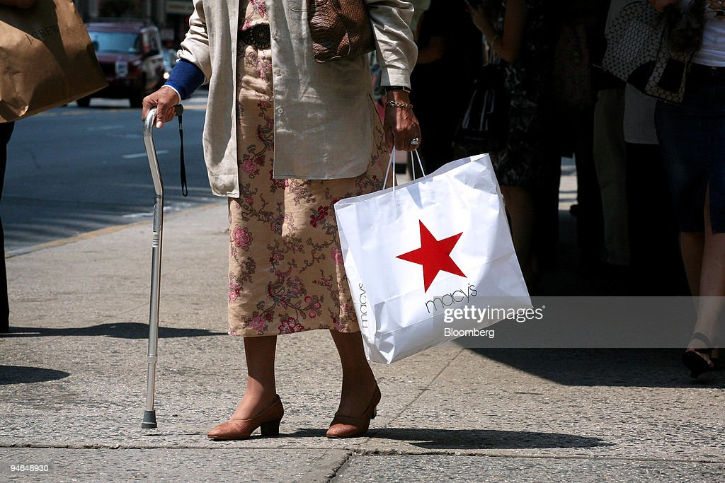 A shopper walks with her purchase outside the Macy's flagship store at Herald Square in New York, Wednesday, Aug. 15, 2007. Macy's Inc., the second-largest department-store chain, reported quarterly profit that exceeded analysts' estimates because of reduced advertising and retirement costs.