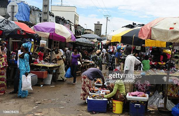 Shopperd buy products at a market in Conakry Guinea on September 19 2010 PHOTO / ISSOUF SANOGO