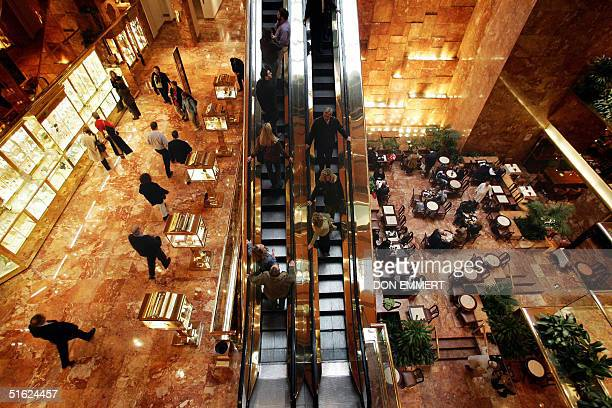 shoppers and diners visit the Trump Tower on 5th Ave in Manhattan 29 October 2004 New York's Fifth Avenue and the ChampsElysees in Paris are the most...