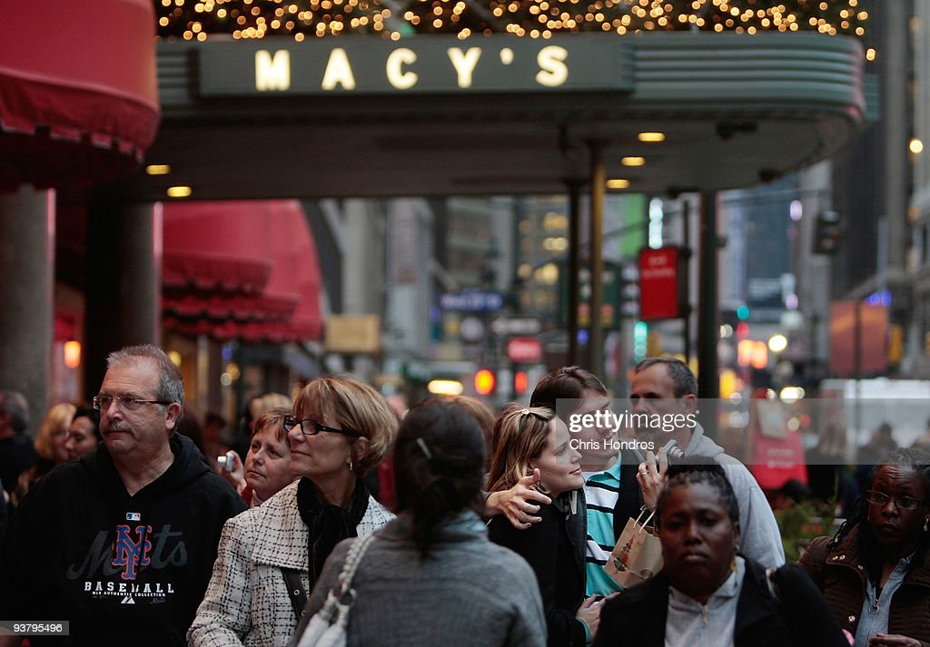 Shoppers and pedestrians stand and walk in front of Macy's December 3, 2009 in New York City. Retail sales declined 0.3 percent, with Macy's dopping 6.1 percent, in November, leading some analysts to fear that the holiday season will not live up to expectations.