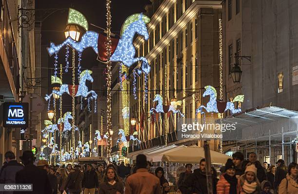 Shoppers and tourists walk through Rua Augusta under Christmas decoration days before Christmas and New Year festivities on December 20 2016 in...