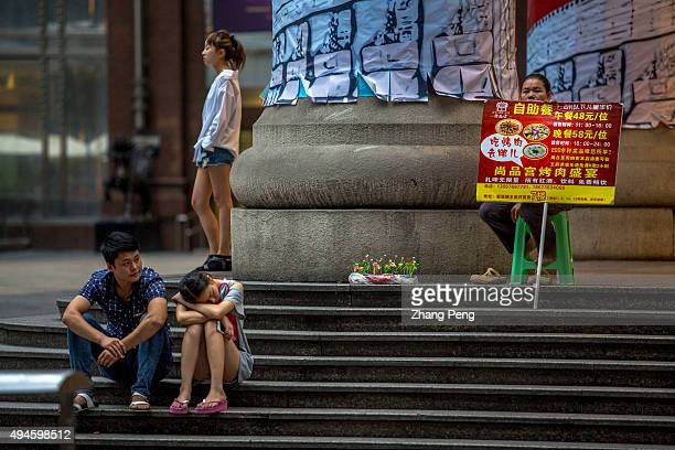 Shoppers and vendors outside a department store at Jiefangbei CBD With a growth rate of 11 percent the municipality of Chongqing has topped China's...