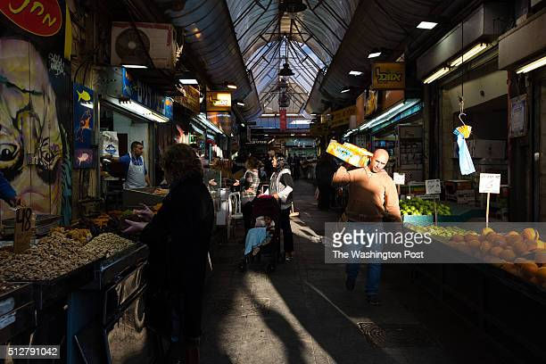 Shoppers and vendors walk through the Mahane Yehuda Market often called 'The Shuk' on February 24 in Jerusalem Israel For a story by William Booth...