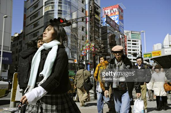 Shoppers and workers walking in Shinjuku District of central Tokyo