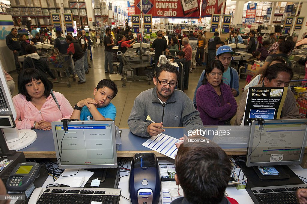 Shoppers apply for a Sam's Club card inside a Sam's Club store in Mexico City, Mexico on Saturday, Nov. 17, 2012. El Buen Fin, Mexico's equivalent of Black Friday, when the year's biggest discounts are offered by participating stores, is held on the third weekend of November and will run through Nov. 19. Photographer: Susana Gonzalez/Bloomberg via Getty Images