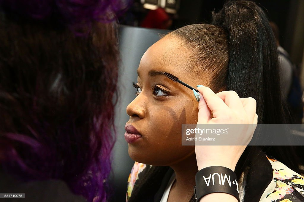 Shoppers apply NYX Professional Makeup during the NYX Professional Makeup Store Kings Plaza Ribbon Cutting and Store Opening on May 25, 2016 in Brooklyn, New York.