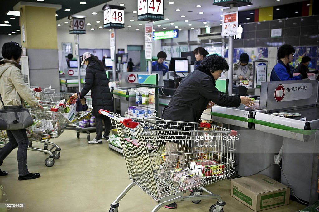 Shoppers approach the check-out counter at Hanaro Mart in Seoul, South Korea, on Tuesday, Feb. 26, 2013. South Korean consumer confidence remained at its highest level since May as gains in the won drove down the prices of imported goods. Photographer: Jean Chung/Bloomberg via Getty Images