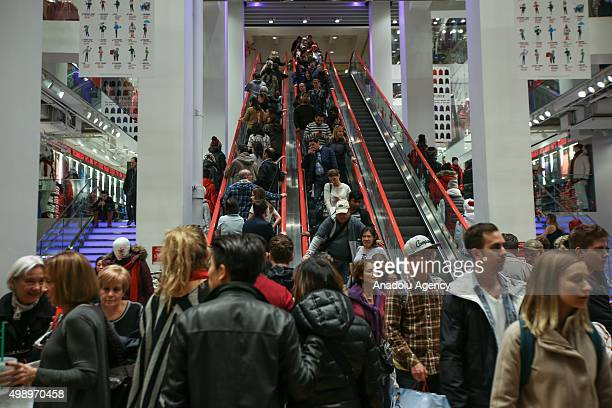 Shoppers are seen at a shop on the first day of Black Friday in New York on November 27 2015 The day after Thanksgiving called Black Friday is...