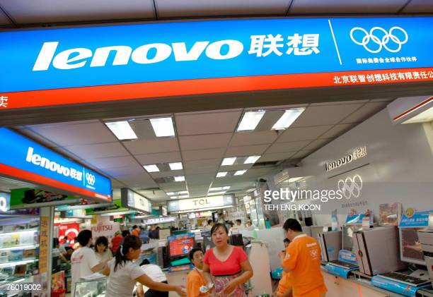 Shoppers are seen at an outlet for China's personal computer maker Lenovo Group at a shopping center in Beijing 08 August 2007 China's Lenovo Group...