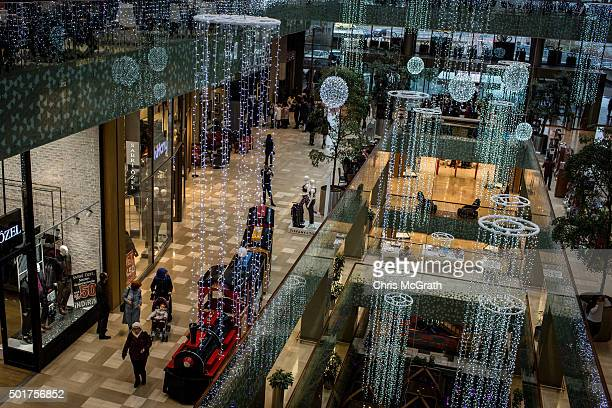 Shoppers are seen inside a luxury shopping mall on December 17 2015 in Istanbul Turkey With the economy expected to grow Turkey is seen as one of the...