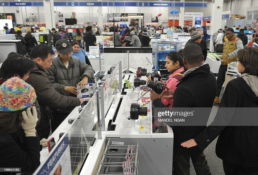 Shoppers are seen inside of a Best Buy store during their Black Friday sale which started at midnight on November 23, 2012 in Rockville, Maryland. Thanksgiving, the last US holiday undisturbed by mass commercialization, is now victim to the ever advancing Christmas shopping season, with stores welcoming shopaholics before the family turkey can be taken from the oven.