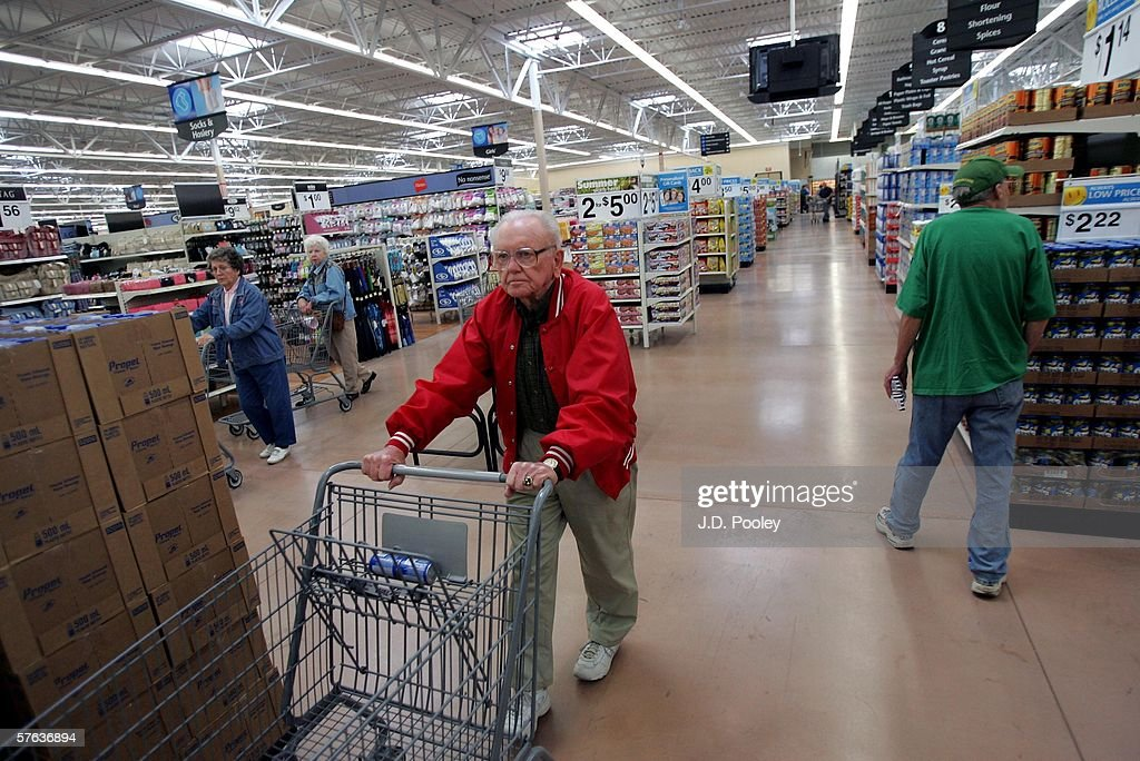 Shoppers are seen inside the new 2,000 square foot Wal-Mart Supercenter store May 17, 2006 in Bowling Green, Ohio. The new store, one of three new supercenters opening today in Ohio, employs 340 people with 60 percent of those working full-time.