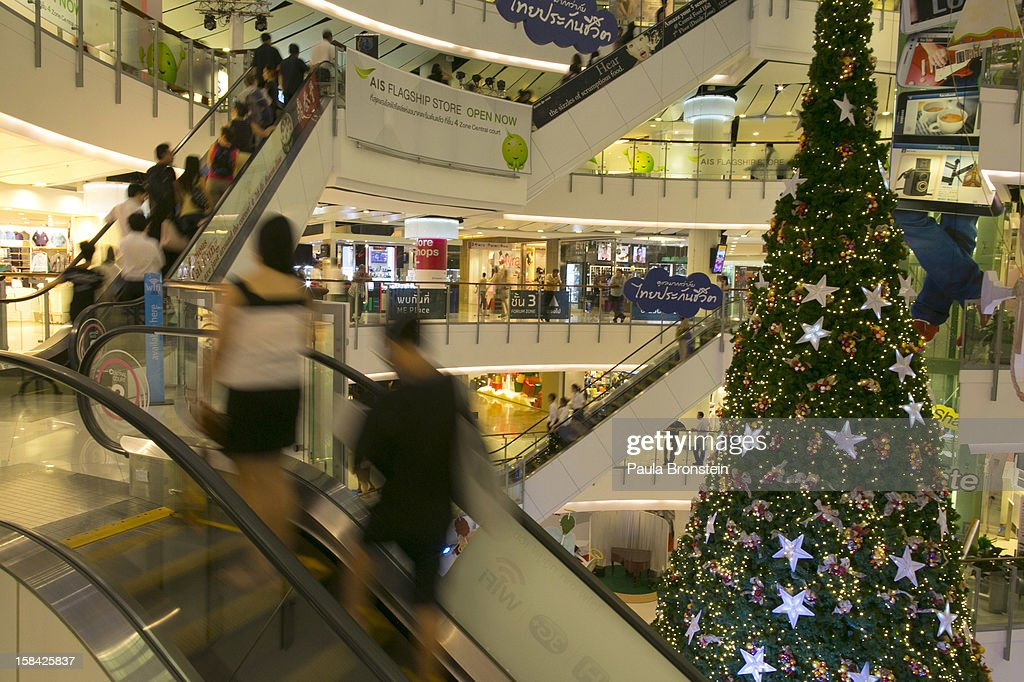 Shoppers are seen on an escalator inside the Paragon mall, one of the Bangkok's most popular shopping centers December 15, 2012 in Bangkok,Thailand.Thailand's high tourist season is booming this year compared to 2011 which was tainted by the flooding as Christmas shoppers visit the shopping malls looking for the bargains.
