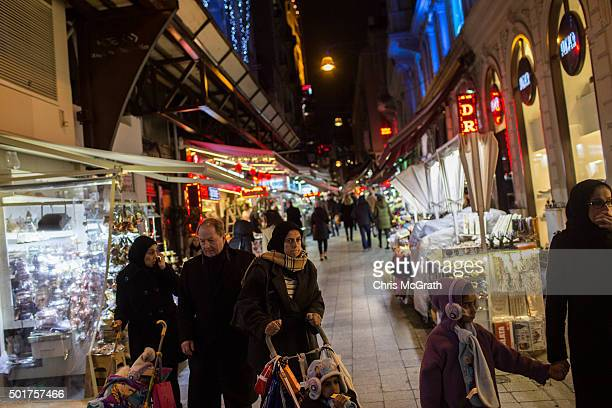Shoppers are seen on the famous Istiklal shopping street on December 17 2015 in Istanbul Turkey With the economy expected to grow Turkey is seen as...