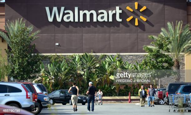 Shoppers are seen outside a Walmart store in Rosemead California on January 29 on a day the world's largest retailer said it will tighten inspections...