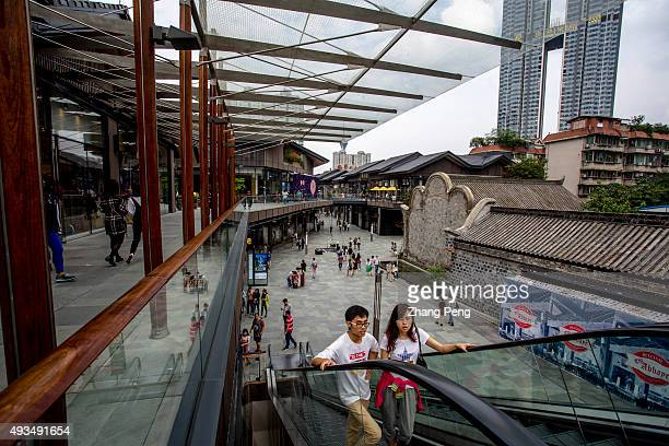 Shoppers are walking in Chengdu SinoOcean Taikoo Li Blending the old and the new Chengdu Taikoo Li incorporates modern building techniques to the...