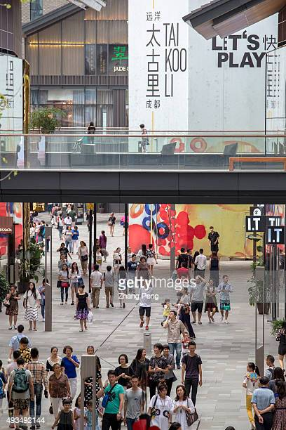 Shoppers are walking in Chengdu Tai Koo Li On Oct7 SinoOcean Taikoo Li Chengdu a 100000 sqm openplan lanedriven retail complex located in the heart...