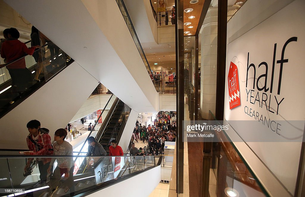 Shoppers arrive through the doors during the Boxing Day sales at the David Jones Market Street store on December 26, 2012 in Sydney, Australia. Boxing Day proves to be one of the busiest days for retail outlets in Sydney with thousands flocking to post-Christmas sales.