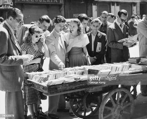 Shoppers at a book stall in El Rastro a sunday street market in Madrid 22nd June 1950