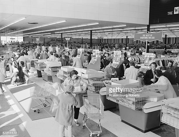Shoppers at checkouts in department store