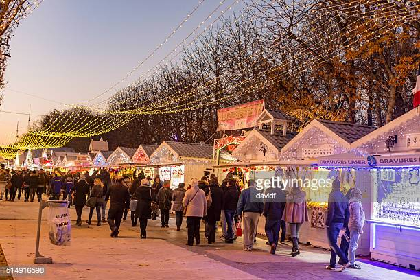 Shoppers At Christmas Market on the Champs Elysees in Paris