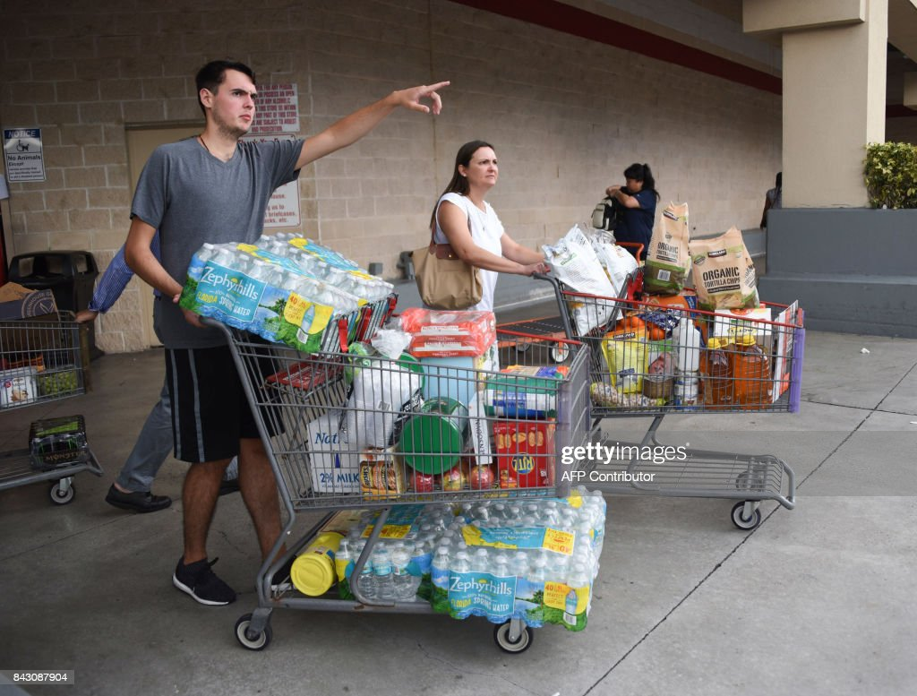 Shoppers at Costco waited up to eight hours for water and essentials in preparation for Hurricane Irma on September 5, 2017 in North Miami. The monster hurricane coming on the heels of Harvey, which struck Texas and Louisiana late last month, is expected to hit a string of Caribbean islands including Guadeloupe late Tuesday before heading to Haiti and Florida. The Miami-based National Hurricane Center said Irma had strengthened to the most powerful Category Five, packing winds of 180 miles (280 kilometers) per hour. PHOTO / Michele Eve Sandberg