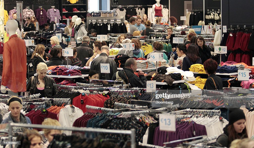 shoppers browse a collection of clothes on sale at a primark store operated by associated - Primark Online Bewerbung