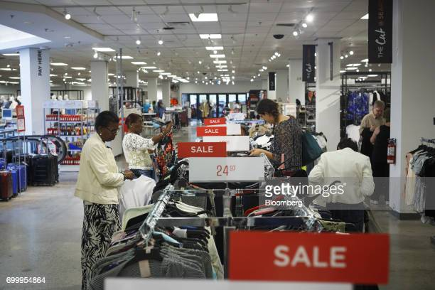 Shoppers browse a 'Sale' rack at a Sears Canada Inc store inside a mall in Toronto Ontario Canada on Thursday June 22 2017 Canadian retailer Sears...