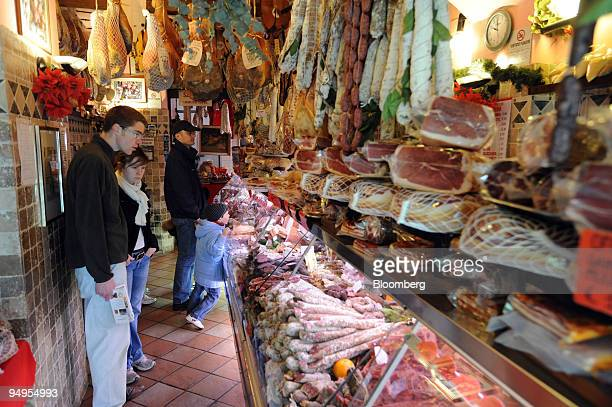 Shoppers browse at a delicatessen in central Rome Italy on Tuesday March 24 2009 Italy is due to release consumer confidence figures on Wednesday