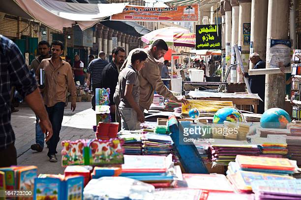Shoppers browse books at the Muntanabi Street book market March 13 2013 in Baghdad Iraq Ten years after the regime of Saddam Hussein was toppled from...