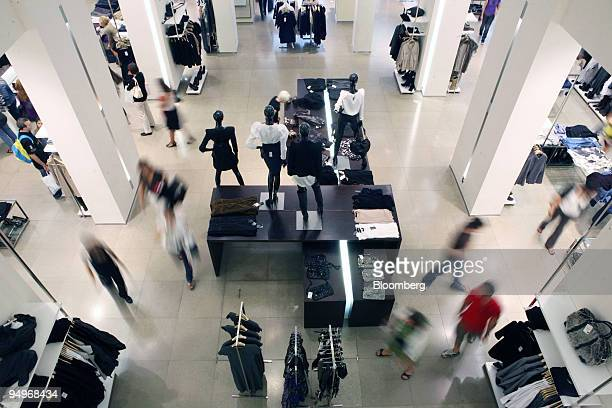 Shoppers browse clothes for sale in a Zara store in Madrid Spain on Tuesday Sept 15 2009 Inditex report earnings tomorrow