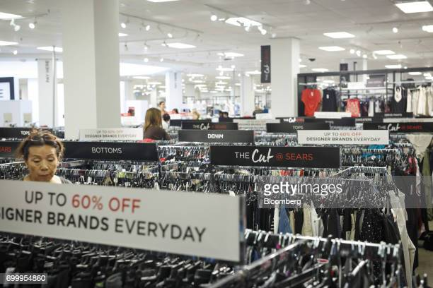 Shoppers browse clothing displayed for sale at a Sears Canada Inc store inside a mall in Toronto Ontario Canada on Thursday June 22 2017 Canadian...
