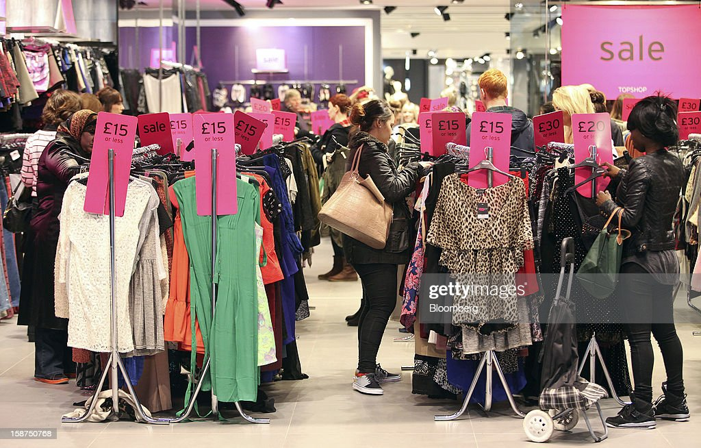 Shoppers browse garments displayed in the sale section of a Topshop store, owned by Arcadia Group Ltd., at the Westfield Stratford City shopping mall in London, U.K., on Thursday, Dec. 27, 2012. Overall Christmas shopping in the U.K. was similar to last year, according to the British Retail Consortium. Photographer: Chris Ratcliffe/Bloomberg via Getty Images