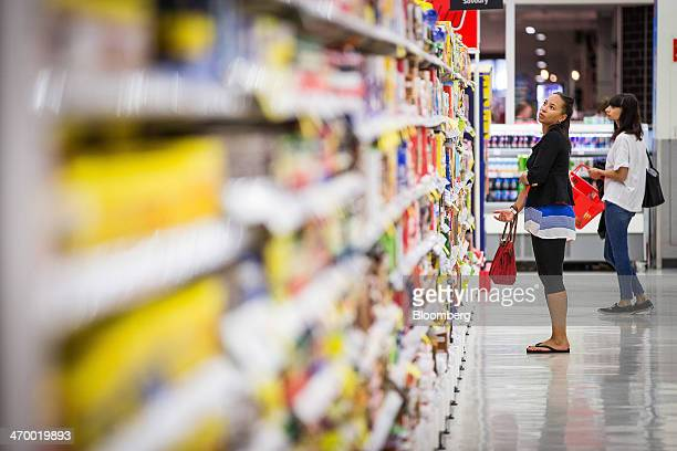 Shoppers browse in an aisle inside a Coles supermarket operated by Wesfarmers Ltd in Sydney Australia on Tuesday Feb 18 2014 Wesfarmers Australia's...