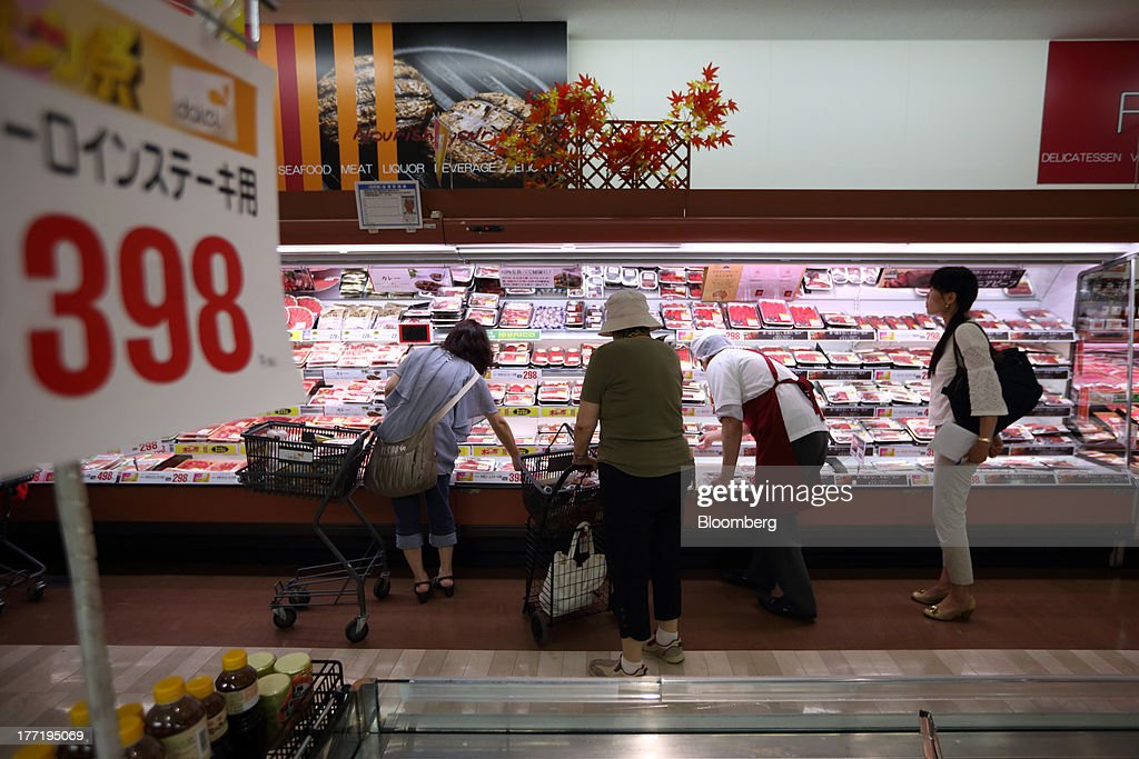 Shoppers browse in the meat section at a Daiei Inc. supermarket during a sale jointly held with Aeon Co. at a Daiei supermarket in Urayasu City, Chiba Prefecture, Japan, on Thursday, Aug. 22, 2013. Aeon's acquisition of 48.4 million Daiei shares will take place on Aug. 27 after the completion of tender offer yesterday, according to a statement to the Tokyo Stock Exchange released today. Photographer: Tomohiro Ohsumi/Bloomberg via Getty Images