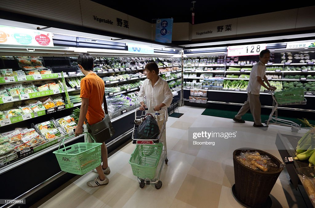 Shoppers browse in the vegetable section at an Aeon Co. supermarket during a sale jointly held with Daiei Inc. at an Aeon supermarket in Tokyo, Japan, on Thursday, Aug. 22, 2013. Aeon's acquisition of 48.4 million Daiei shares will take place on Aug. 27 after the completion of tender offer yesterday, according to a statement to the Tokyo Stock Exchange released today. Photographer: Tomohiro Ohsumi/Bloomberg via Getty Images