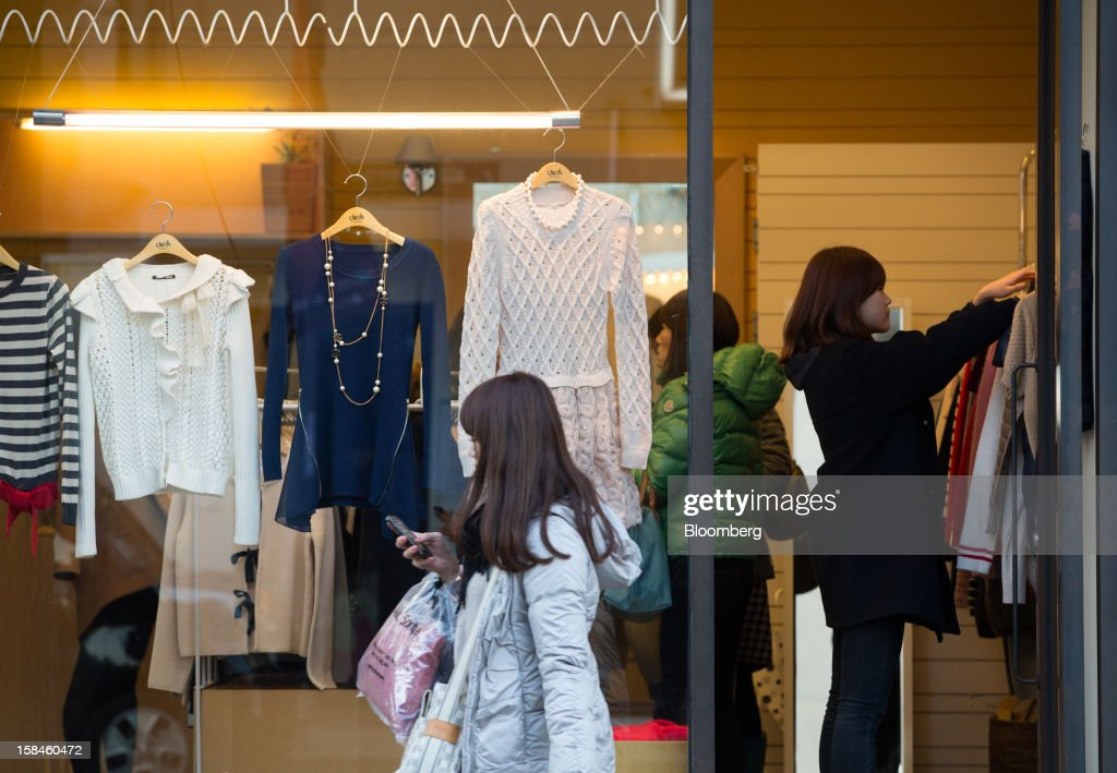 Shoppers browse inside a clothing store on Garosugil street in the Gangnam district of Seoul, South Korea, on Saturday, Dec. 15, 2012. South Koreans vote on Dec. 19 to replace President Lee Myung Bak, whose five-year term ends in February. Photographer: SeongJoon Cho/Bloomberg via Getty Images