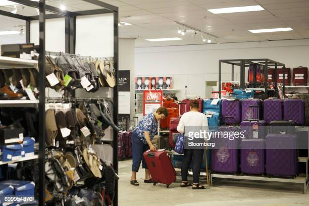 Shoppers browse luggage displayed for sale at a Sears Canada Inc store inside a mall in Toronto Ontario Canada on Thursday June 22 2017 Canadian...