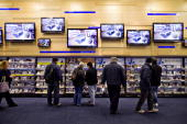 Shoppers browse merchandise at a Best Buy store in New York US on Tuesday Dec 15 2009 Best Buy Co the largest electronics retailer said its...