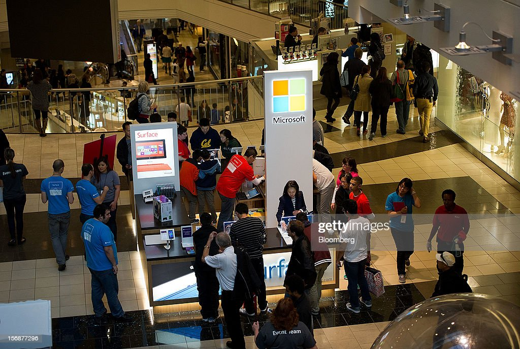 Shoppers browse merchandise at a Microsoft Corp. pop-up store in the Westfield San Francisco Centre in San Francisco, California, U.S., on Friday, Nov. 23, 2012. To get shoppers to spend more than last year, retailers have continued to turn Black Friday, originally a one-day event after Thanksgiving, into a week's worth of deals and discounts. Photographer: David Paul Morris/Bloomberg via Getty Images