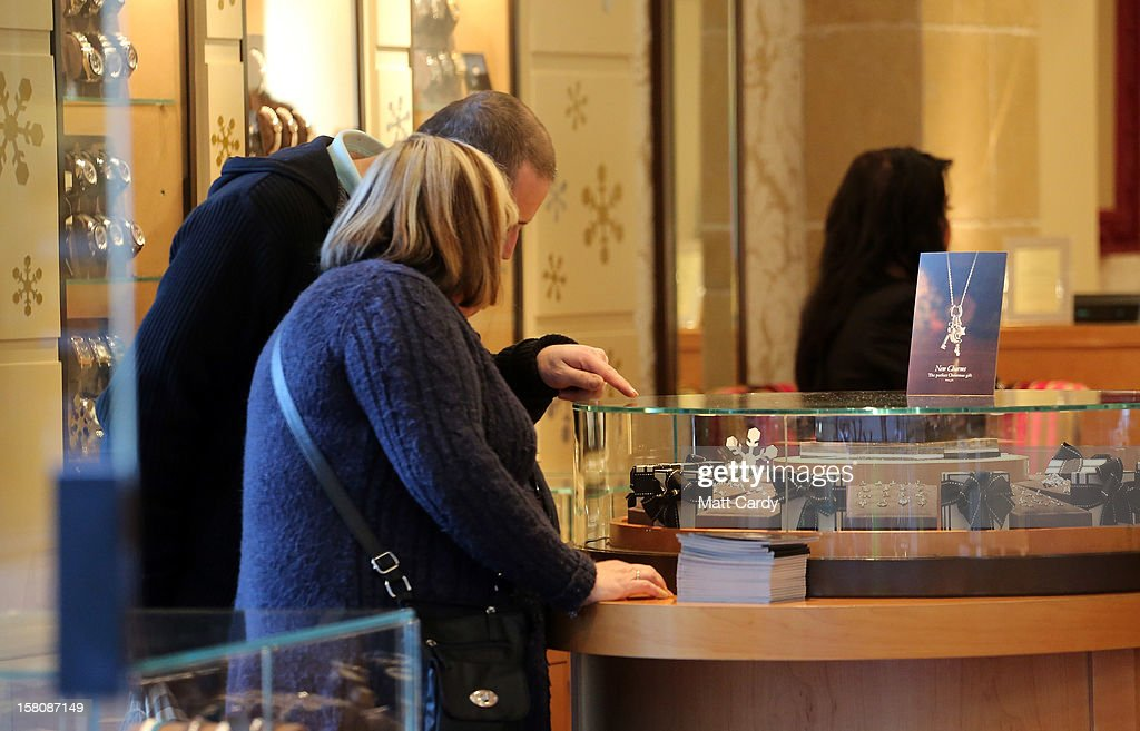 Shoppers browse merchandise in a jewellry shop on December 10, 2012 in Bristol, England. With internet shopping still on the rise, many traditional retailers claim this Christmas could be the one that will determine the future of the high street.