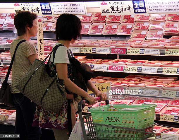 Shoppers browse packages of Wagyu beef sold under the Topvalu brand at an Aeon Co supermarket in Tokyo Japan on Thursday July 28 2011 Concern that...