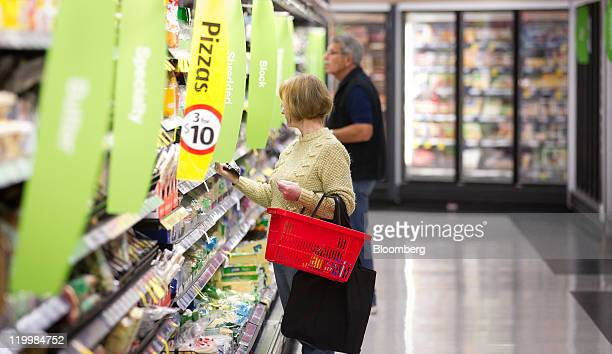 Shoppers browse products in the cheese section at a Wesfarmers Ltd Coles supermarket in Sydney Australia on Thursday July 28 2011 Wesfarmers Ltd...