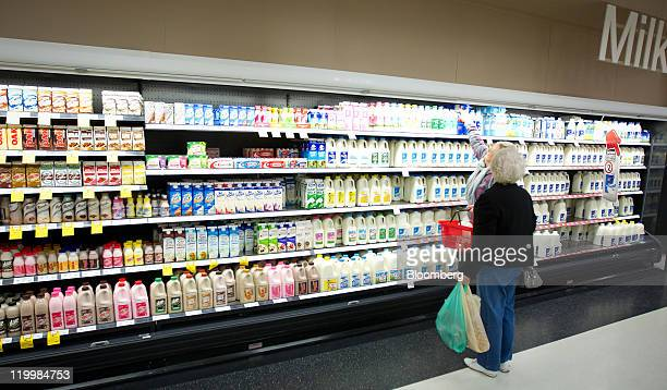 Shoppers browse products in the milk section at a Wesfarmers Ltd Coles supermarket in Sydney Australia on Thursday July 28 2011 Wesfarmers Ltd...