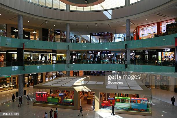 Shoppers browse retail floors above an Hermes luxury store inside the Dubai Mall operated by Emaar Malls Group in the downtown district of Dubai...