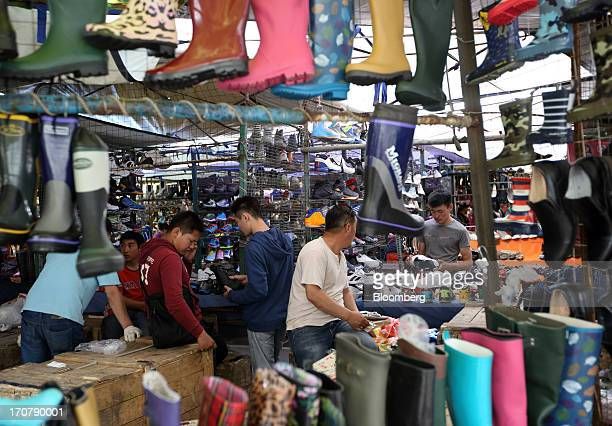 Shoppers browse shoes at a market in Ulaanbaatar Mongolia on Thursday June 13 2013 Mongolia a country of almost 29 million people is experiencing...