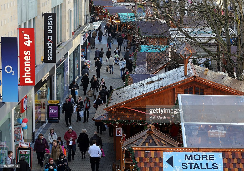 Shoppers browse stalls at a Christmas market on December 10, 2012 in Bristol, England. With internet shopping still on the rise, many traditional retailers claim this Christmas could be the one that will determine the future of the high street.