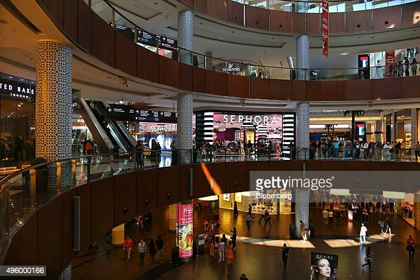 Shoppers browse stores inside the Dubai Mall retail complex operated by Emaar Malls Group in the downtown district of Dubai United Arab Emirates on...