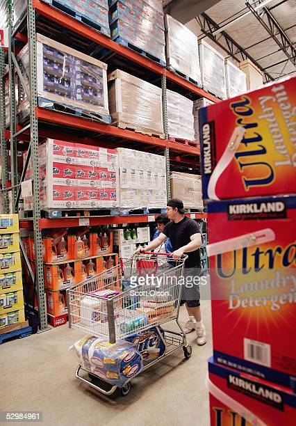 Shoppers browse the detergent selection at a Costco Store May 26 2005 in Chicago Illinois Costco reported today an increase of six percent in third...